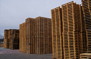 Tall stacks of wooden pallets